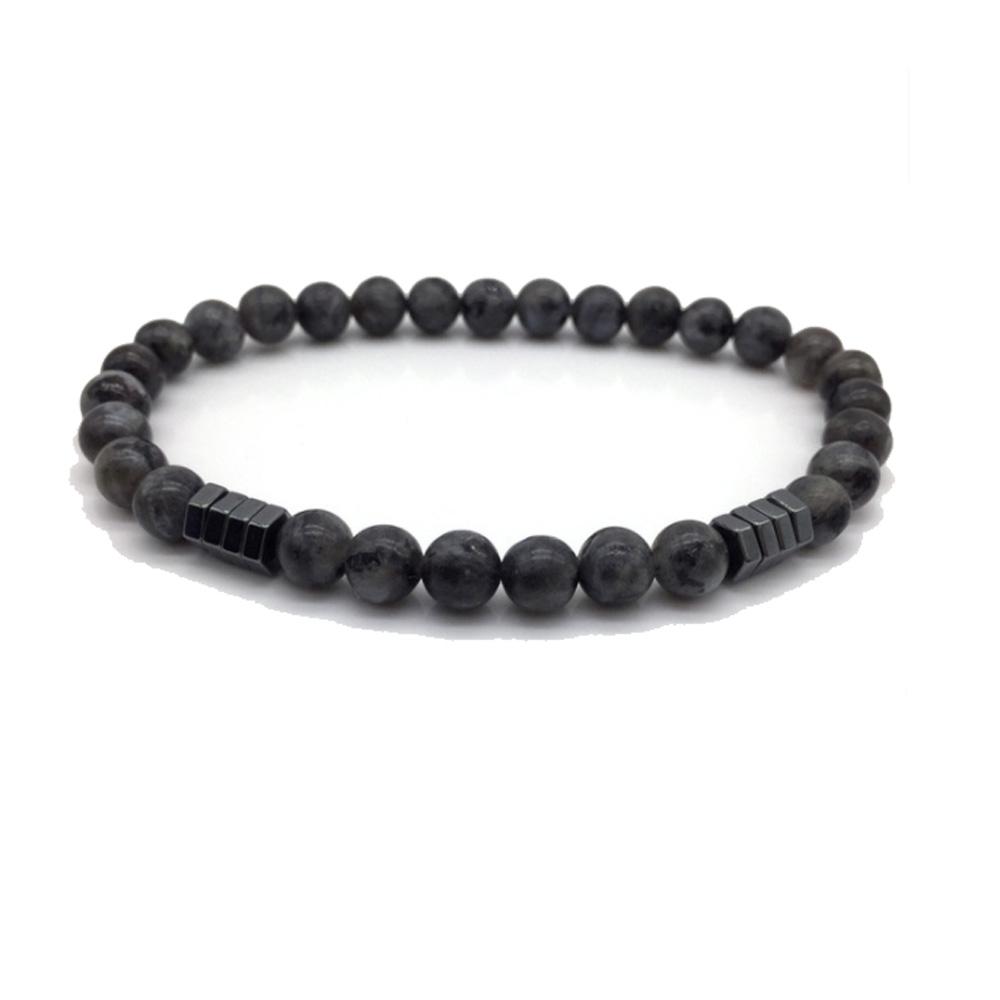 Image of   Polerede sorte sten med sort stål detaljer