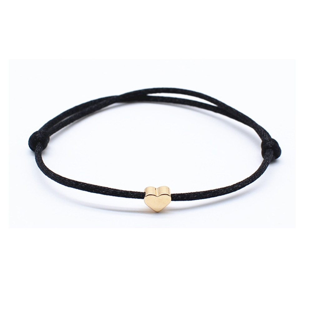 Image of   simpelt sort armbånd med guld hjerte